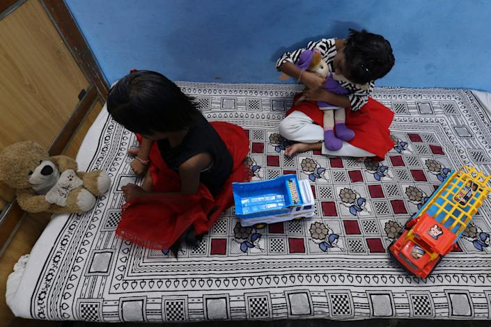 Twin sisters Tripti and Pari, names changes, lost both their parents due to the Covid-19. They have been living with their relatives in Bhopal (AFP via Getty Images)