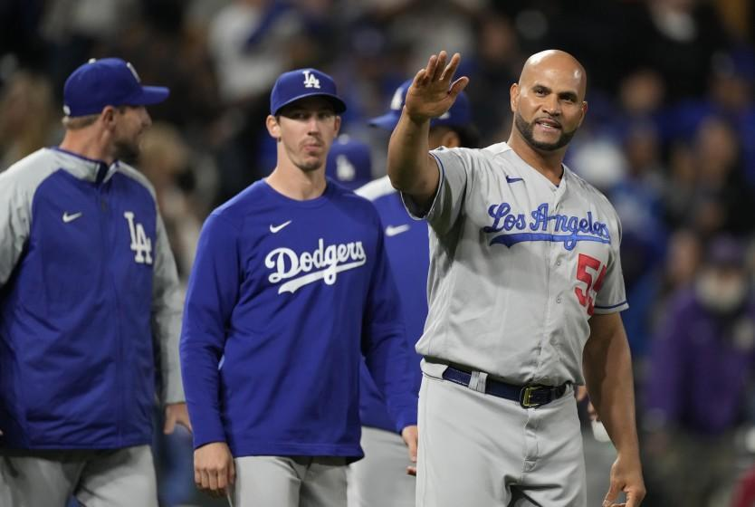 Los Angeles Dodgers' Albert Pujols waves to fans after the 10th inning of a baseball game against the Colorado Rockies Tuesday, Sept. 21, 2021, in Denver. The Dodgers won 5-4 behind an RBI-single hit by Pujols in the 10th inning. (AP Photo/David Zalubowski)