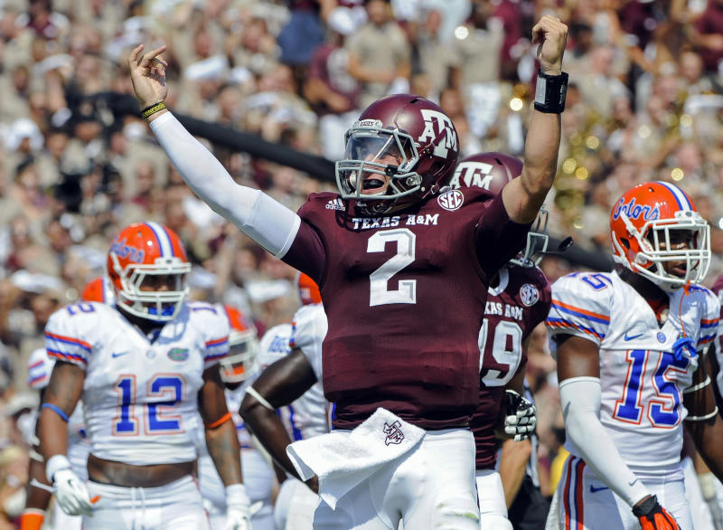 FILE - In this Sept. 8, 2012 file photo, Texas A&M's Johnny Manziel (2) reacts after a touchdown run during the second quarter of an NCAA college football game against Florida in College Station, Texas. Heisman winner Manziel will lead Texas A&M against Oklahoma in the Cotton Bowl on Jan. 4. (AP Photo/Dave Einsel, File)