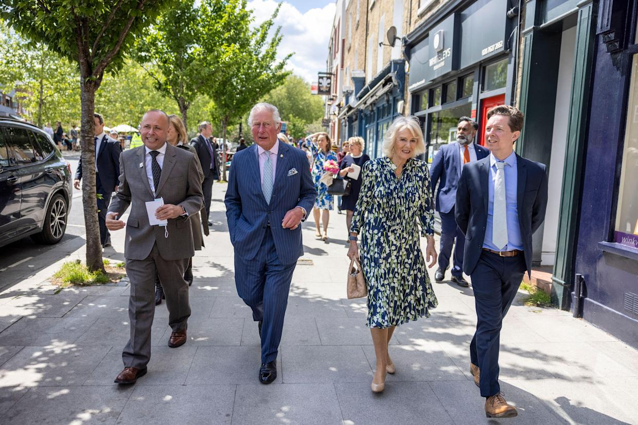 Britain's Prince Charles, Prince of Wales and Britain's Camilla, Duchess of Cornwall walk with Jeremy Keates, Manager of This is Clapham and Christopher Wellbelove, Councillor at Clapham Town Ward during a visit to Clapham Old Town, south London on May 27, 2021. (Photo by Heathcliff O'Malley / POOL / AFP) (Photo by HEATHCLIFF O'MALLEY/POOL/AFP via Getty Images)