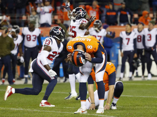 FILE - In this Sunday, Nov. 4, 2018, file photo, Denver Broncos kicker Brandon McManus (8) reacts after missing what could have been the game-winning field goal in the second half of an NFL football game as the Houston Texans celebrate in Denver. The Broncos hit their bye week with a 3-6 record, in danger of posting back-to-back losing seasons for the first time since 1971-72. (AP Photo/Jack Dempsey, File)