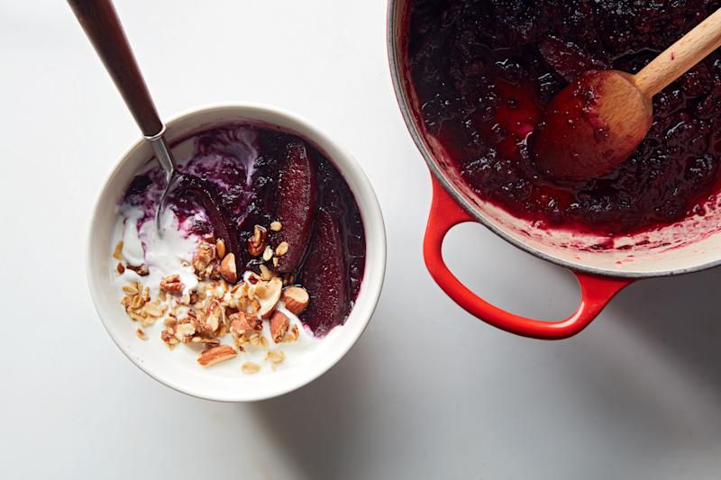 This apple compote is half blueberries, and here I'm eating it in a bowl that's half yogurt, with some crunchy granola on top. I was proud of getting it into the bowl exactly in half like that, but it's tastier once you swirl it together.