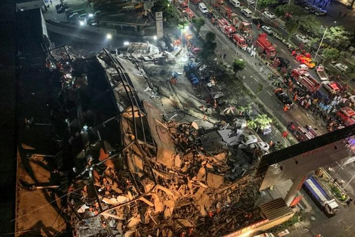 Dozens have so far been rescued from the rubble of the 80-room Xinjia hotel in Quanzhou city (AFP Photo/STR)