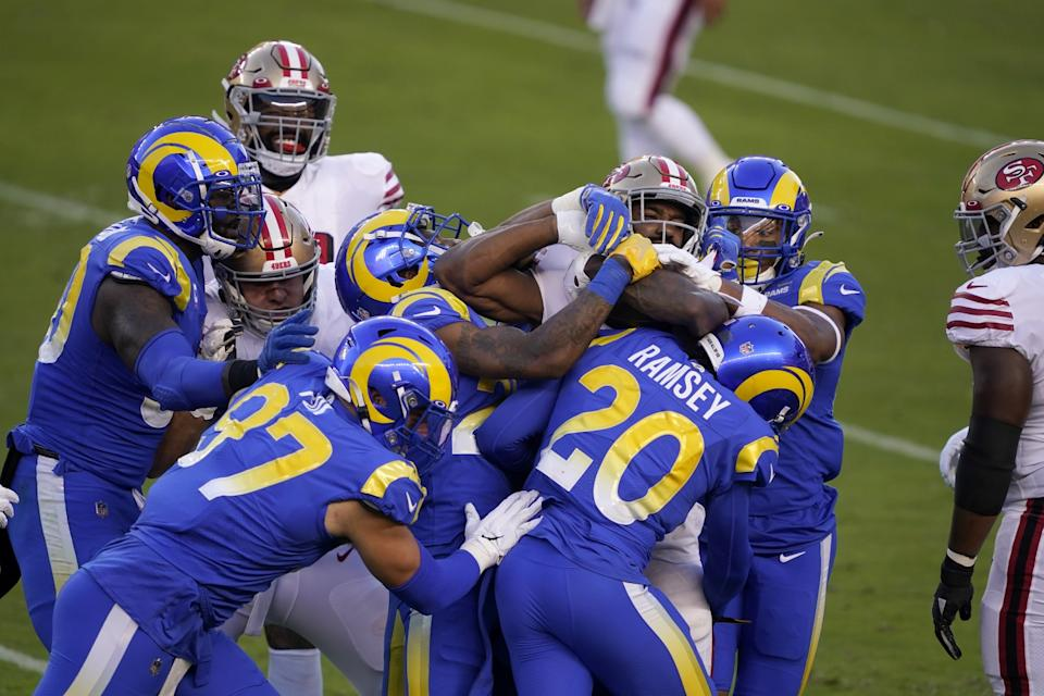 San Francisco's Raheem Moster is tackled by a slew of Ram defenders during their battle won by the 49ers on Oct. 18.