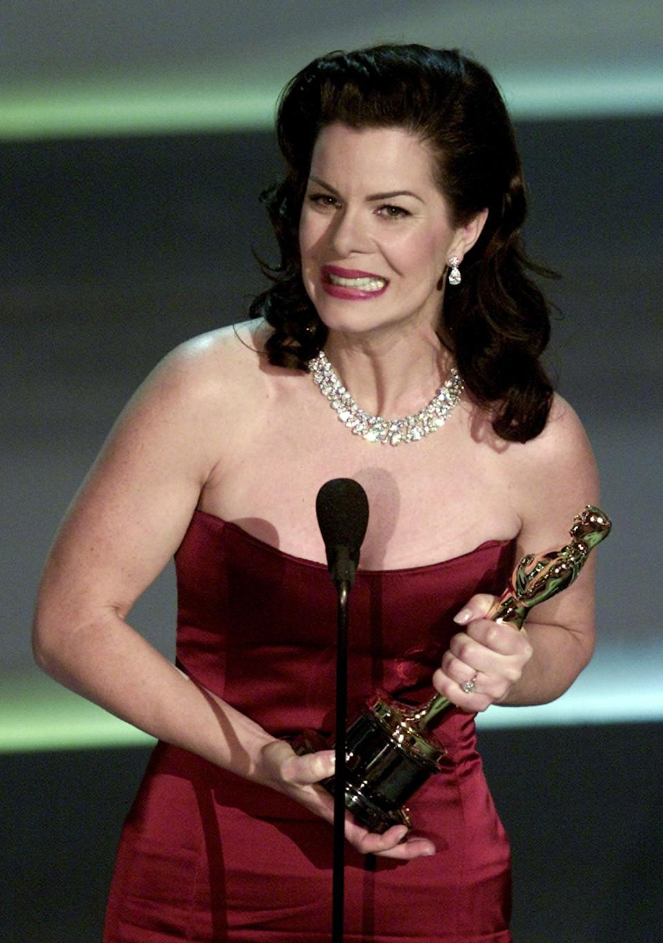 Marcia Gay Harden accepts her Oscar for Best Supporting Actress at the 73rd annual Academy Awards in Los Angeles March 25, 2001. Harden won for her role in the movie