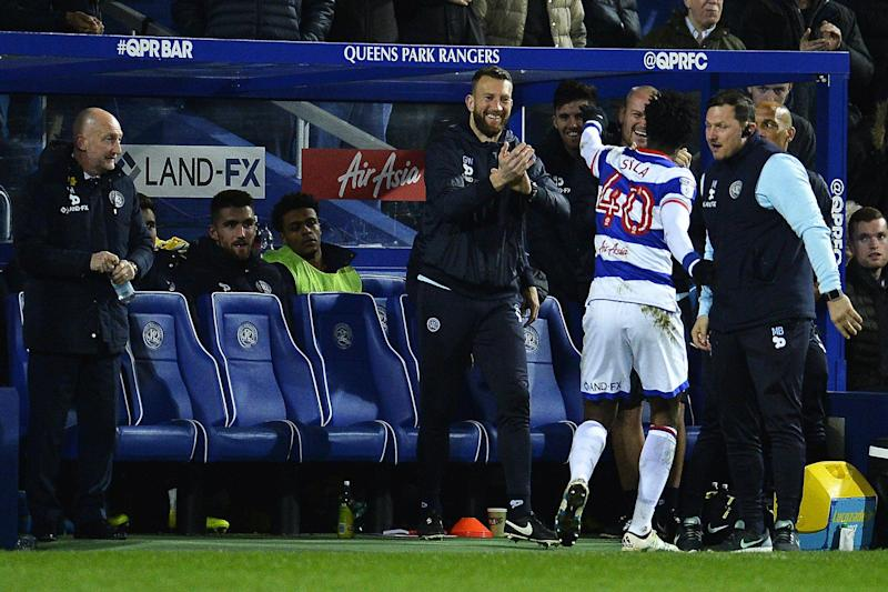Holloway watches on as Idrissa Sylla celebrates: Getty Images