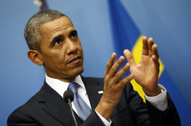 U.S. President Barack Obama speaks about Syria during a joint news conference with Swedish Prime Minister in Stockholm