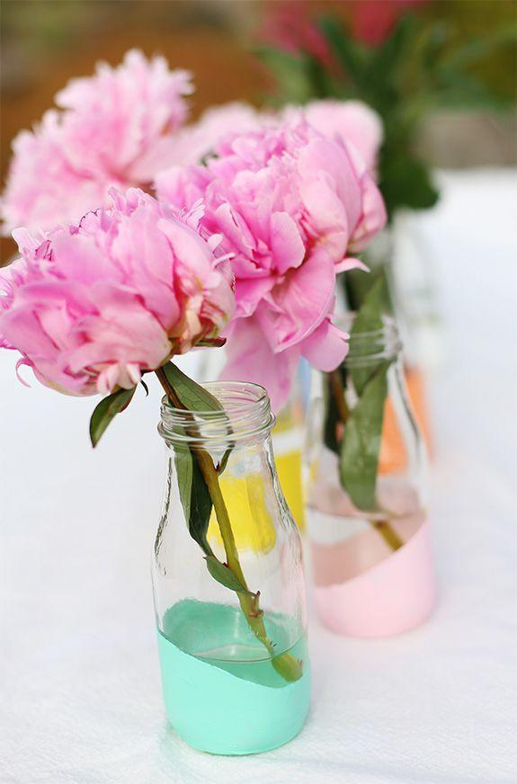 """<p>Stretch a rubber band around empty milk bottles to paint a geometric look. Fill with flowers in a similar color family for a fresh, spring-ready look. </p><p><em><a href=""""http://sayyes.com/2013/06/pastel-dipped-milk-bottle-vases.html"""" rel=""""nofollow noopener"""" target=""""_blank"""" data-ylk=""""slk:Get the tutorial from Say Yes »"""" class=""""link rapid-noclick-resp"""">Get the tutorial from Say Yes »</a></em> </p>"""