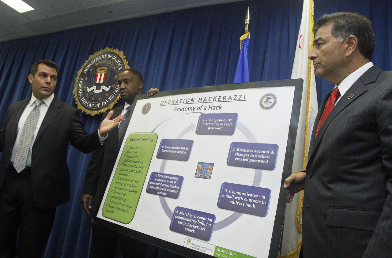 Cameron Malin, left, FBI supervisory special agent, U.S. Attorney Andre Birotte Jr., right, and Assistant Director in Charge of the FBI's Los Angeles office Steven Martinez, right, announce the arrest of Christopher Chaney, 35, of Jacksonville, Fla., accused of targeting individuals in the entertainment industry by hacking into their email accounts, at a news conference at FBI headquarters in Los Angeles Wednesday, Oct. 12, 2011. Celebrities allegedly hacked include Christina Aguilera, Mila Kunis, Simone Harouche, Scarlett Johansson, Renee Olstead and several others. Chaney was to be arraigned in Jacksonville Wednesday afternoon. (AP Photo/Reed Saxon)