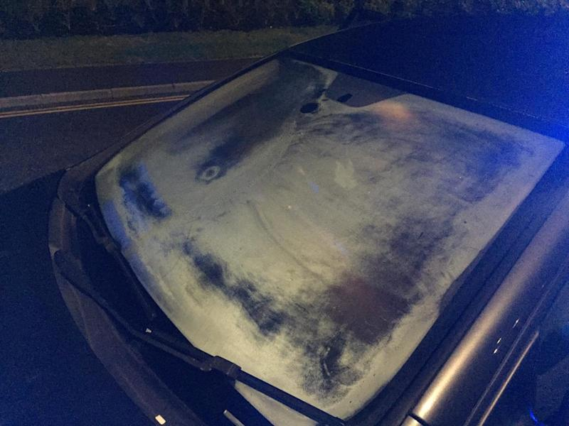 """The almost entirely iced up windscreen of a driver pulled over by police iin Rugby, Warks., on Thursday (20/2). See SWNS story SWMDwindow. Cops pulled over a """"blindfolded"""" motorist who drove with frost almost entirely covering their windscreen. The reckless driver was pulled over in Rugby, Warks., on Thursday (20/2) night after traffic cops became concerned about his visibility. Officers from Warwickshire Police posted pictures of the car on Facebook, saying the motorist was effectively driving """"blindfolded."""" Writing on the OPU Warwickshire page, they wrote: """"So... quite what the driver could see through their windscreen I'd suggest is slightly limited!"""