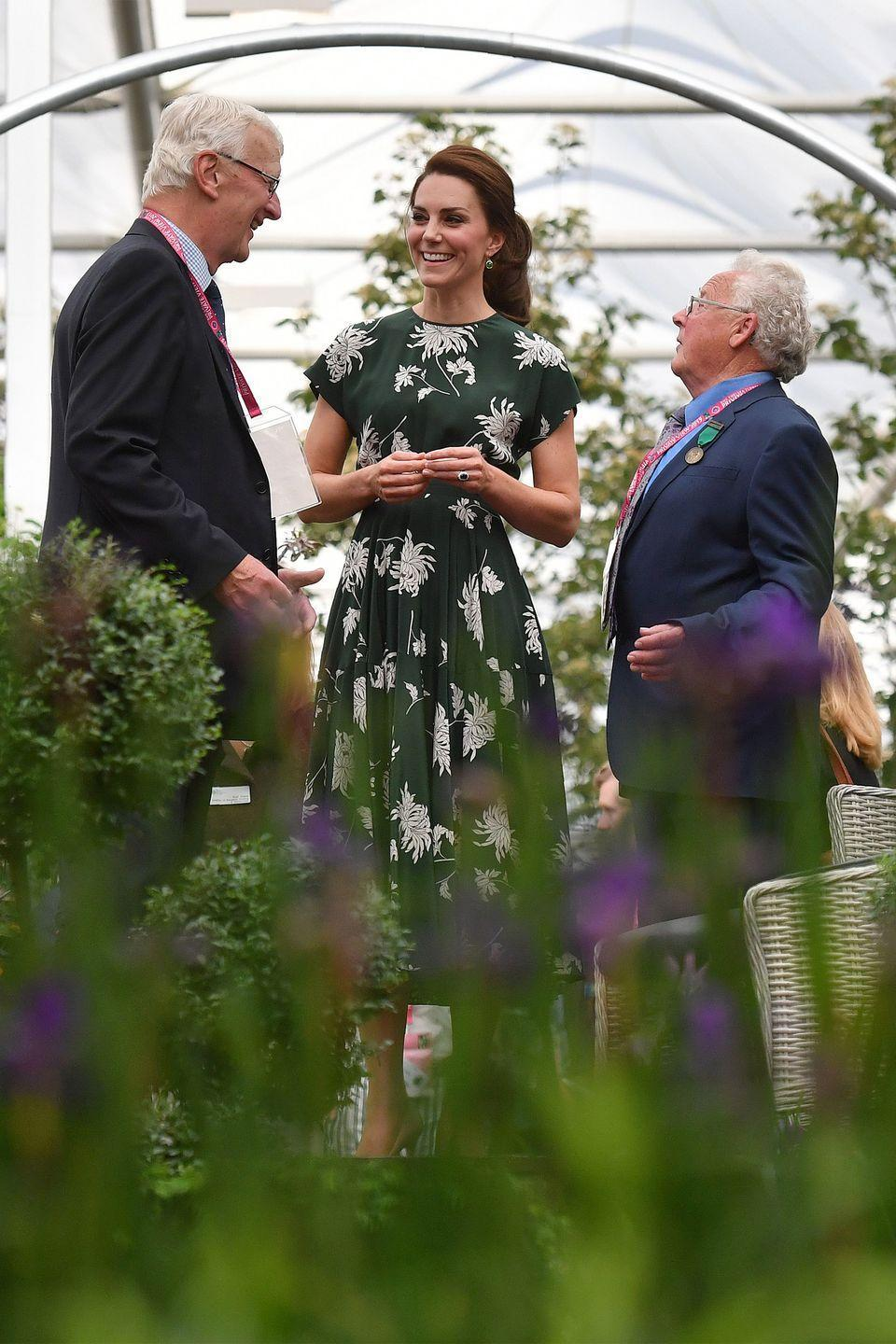 <p>Middleton sports a green floral silk dress by Rochas with nude pumps while visiting the annual Chelsea Flower Show in London.</p>