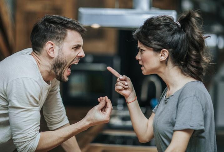 Man screaming at a woman who is pointing her finger at him
