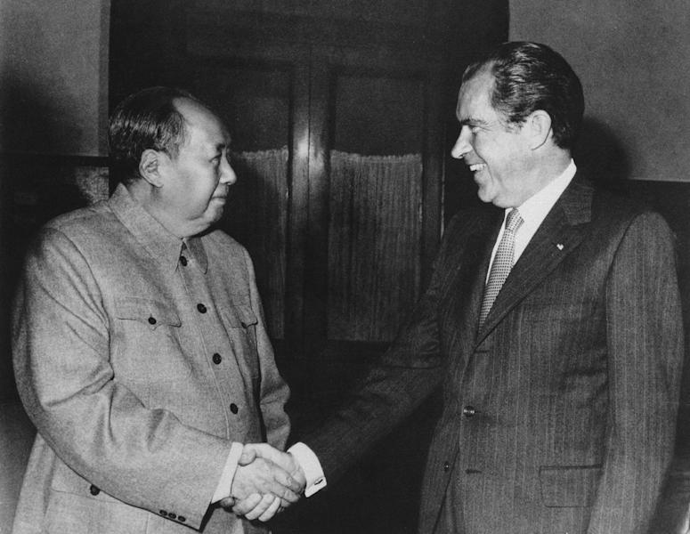 FILE - In this Feb. 21, 1972, file photo, Chinese communist party leader Mao Tse-Tung, left, and U.S. President Richard Nixon shake hands as they meet in Beijing. Nixon's visit marked the first time an American president visited China. (AP Photo/File)