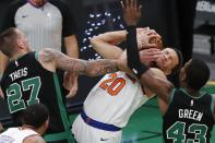 Boston Celtics' Daniel Theis (27) and Javonte Green (43) battle New York Knicks' Kevin Knox II (20) for a rebound during the first half of an NBA basketball game, Sunday, Jan. 17, 2021, in Boston. (AP Photo/Michael Dwyer)