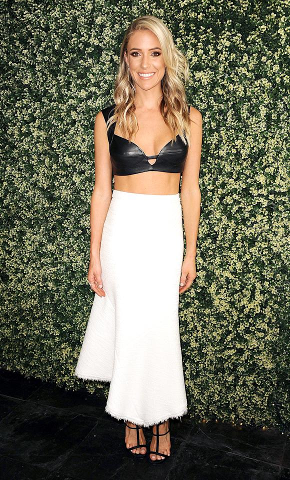 <p>The former reality star was all party on the top in her Rubin singer leather bralette and business on the bottom in a high-waisted midi skirt at the the launch event for her jewelry line Uncommon James in L.A. (Photo: Jason LaVeris/Getty Images) </p>