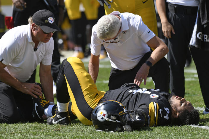 Pittsburgh Steelers defensive end Tyson Alualu (94) is tended to by a team doctor after being injured during the first half of an NFL football game against the Las Vegas Raiders in Pittsburgh, Sunday, Sept. 19, 2021. (AP Photo/Don Wright)