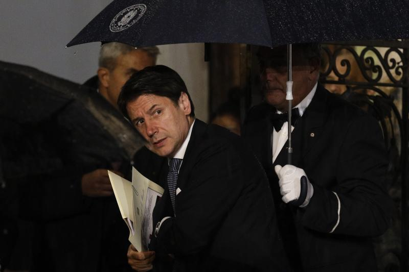 Italian Premier Giuseppe Conte arrives for a meeting with German Chancellor Angela Merkel, in Rome, Monday, Nov. 11, 2019. (AP Photo/Gregorio Borgia)