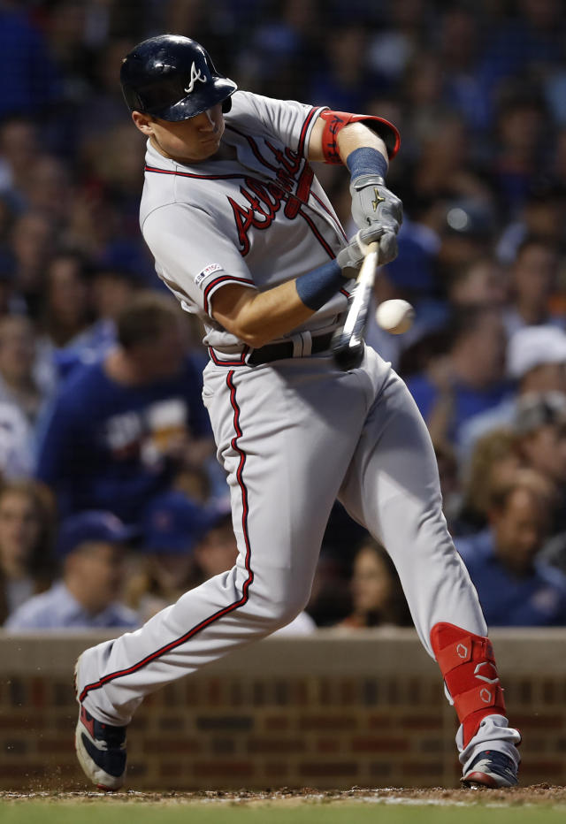 Atlanta Braves' Austin Riley hits a double against the Chicago Cubs during the fifth inning of a baseball game Monday, June 24, 2019, in Chicago. (AP Photo/Jim Young)
