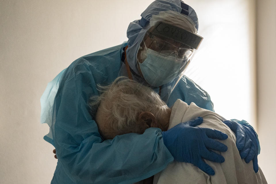 Dr Joseph Varon hugs and comforts a patient in the Covid-19 intensive care unit of a Houston hospital. Source: Getty