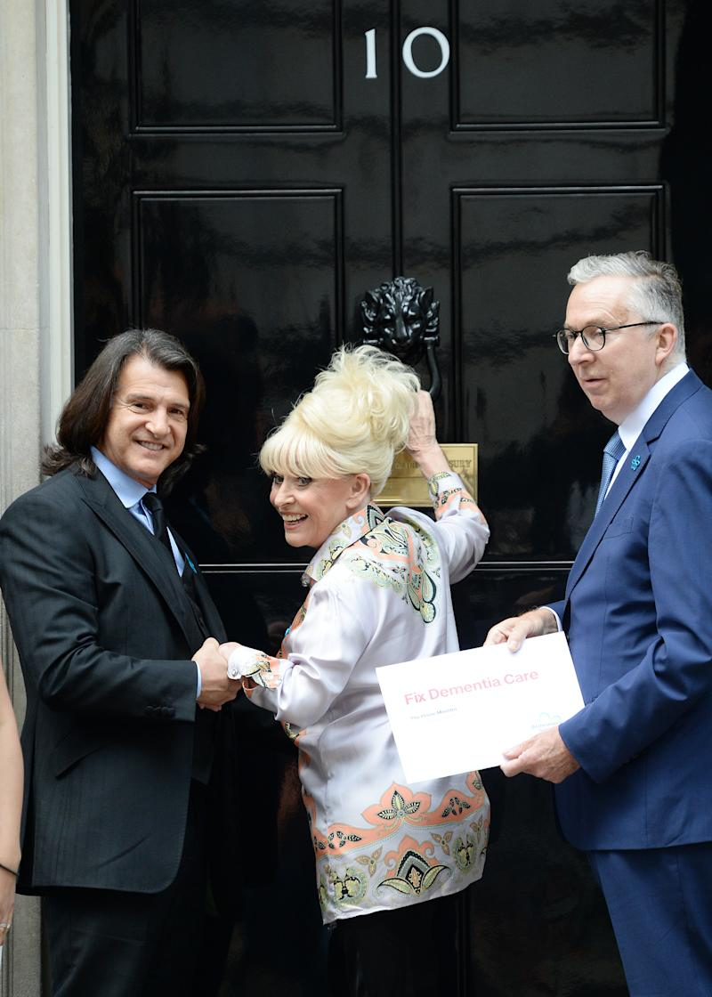 LONDON, ENGLAND - SEPTEMBER 02: Scott Mitchell and Dame Barbara Windsor Alzheimer's Society open letter hand in at 10 Downing Street on September 02, 2019 in London, England. Alzheimer's Society's Fix Dementia Care campaign calls on the Government to provide a long-term funding solution to end the social care crisis. (Photo by Eamonn M. McCormack/Getty Images)