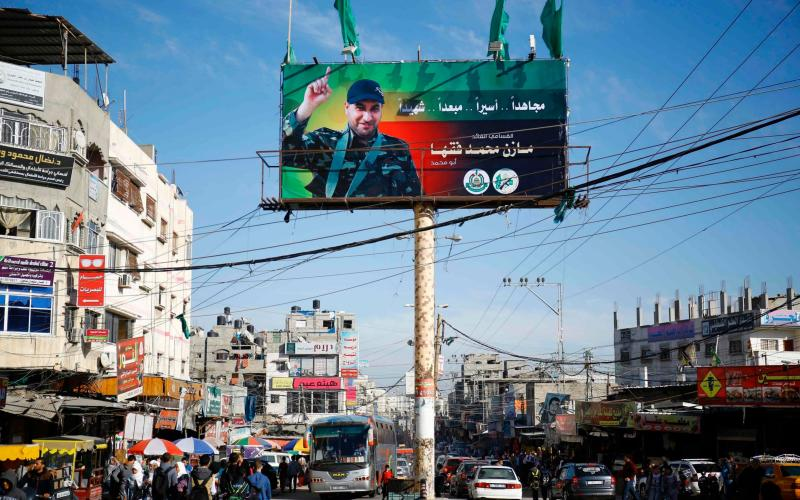 A billboard displays a picture of one Mazen Faqha after he was shot dead in Gaza City.  - Credit: FP PHOTO / MOHAMMED ABED