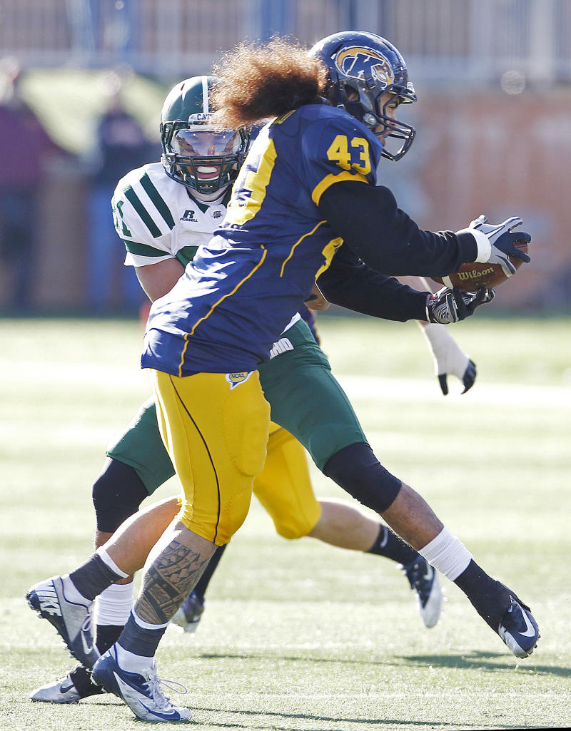 Kent State's C.J. Malauulu makes an interception in front of Ohio's Tyler Futrell and returns in for a touchdown during the first quarter of an NCAA college football game, Friday, Nov. 23, 2012, in Kent, Ohio.  (AP Photo/Ron Schwane)