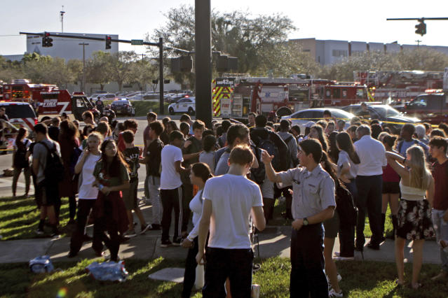 <p>Students are released from a lockdown following a shooting at Marjory Stoneman Douglas High School in Parkland, Fla., on Feb. 14, 2018. (Photo: John McCall/South Florida Sun-Sentinel via AP) </p>