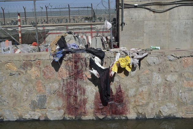 Clothes and blood stains of Afghan people who were waiting to be evacuated are seen at the site of the August 26 twin suicide bombs, which killed scores of people including 13 US troops, at Kabul airport on August 27, 2021. (Photo by WAKIL KOHSAR / AFP) (Photo by WAKIL KOHSAR/AFP via Getty Images) (Photo: WAKIL KOHSAR via Getty Images)