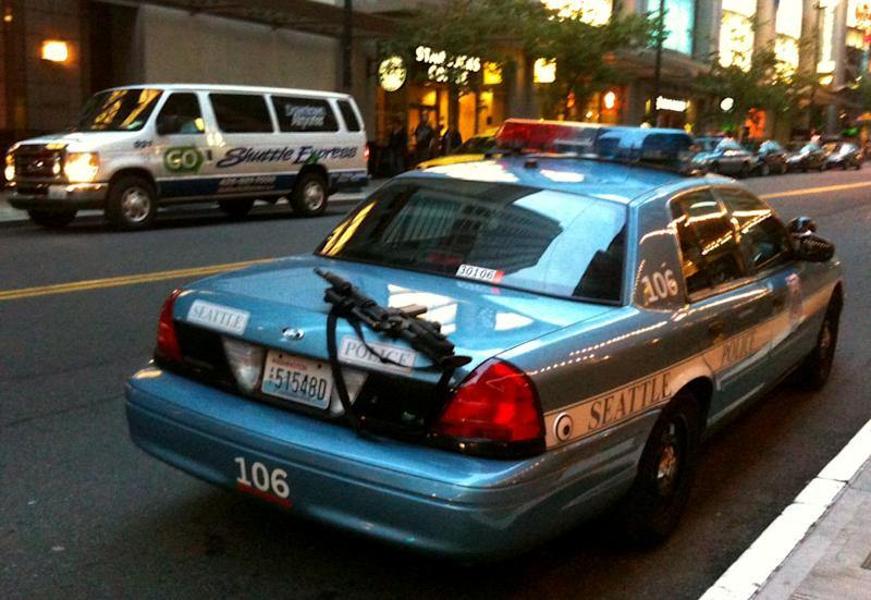 This handout photo provided by Nick Gonzalez for editorial purposes only, shows a police rifle left unattended on a patrol car outside a busy downtown area on Tuesday, June 28, 2011, in Seattle. A Seattle police spokesman says the department has launched an investigation into the incident.  Rifles are assigned only to officers who have additional training and are usually kept in the trunk or between the driver and passenger seats. (AP Photo/Nick Gonzalez)
