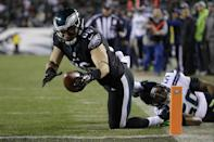Philadelphia Eagles' Brent Celek dives for the endzone for a touchdown during the second half of an NFL football game against the Seattle Seahawks, Sunday, Dec. 7, 2014, in Philadelphia. (AP Photo/Matt Rourke)