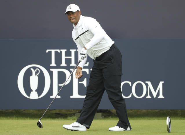 Tiger Woods of the United States watches his ball after playing off the 1st tee during the second round of the British Open Golf Championships at Royal Portrush in Northern Ireland, Friday, July 19, 2019.(AP Photo/Peter Morrison)