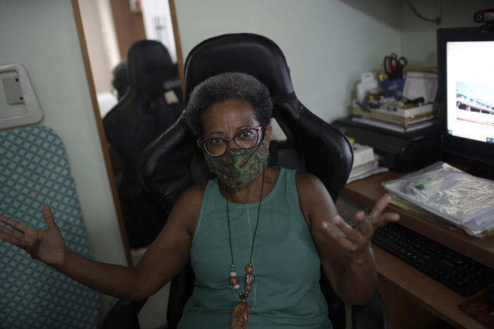Dr. Regina Flauzino speaks during an interview in her home in Rio de Janeiro, Brazil, Friday, Jan. 15, 2021. Like many Brazilian public health experts, Flauzino spent most of 2020 watching with horror as COVID-19 devastated Brazil. (AP Photo/Silvia Izquierdo)