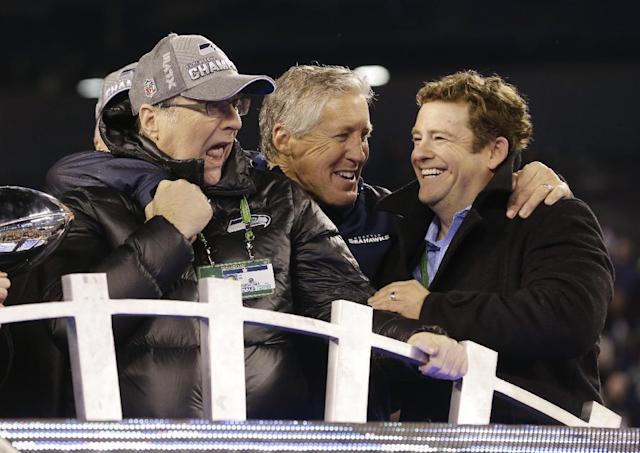 Seattle Seahawks head coach Pete Carroll, center, celebrates with Seattle Seahawks owner Paul Allen, left, and general manager John Schneider, right, after the NFL Super Bowl XLVIII football game against the Denver Broncos Sunday, Feb. 2, 2014, in East Rutherford, N.J. The Seahawks won 43-8. (AP Photo/Ted S. Warren)