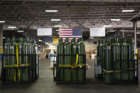 In this photo provided by the U.S. Air Force, pallets of oxygen tanks sit in the 60th Aerial Port Squadron warehouse on Tuesday, April 27, 2021, at Travis Air Force Base, Calif. The United States is donating medical supplies to assist the country of India in its fight against COVID-19. The donation of 440 oxygen cylinders and regulators, one million N95 masks and one million COVID-19 rapid diagnostic kits, will be transported to India aboard a U.S. Air Force C-5M Super Galaxy. (Alexander Merchak/U.S. Air Force via AP)