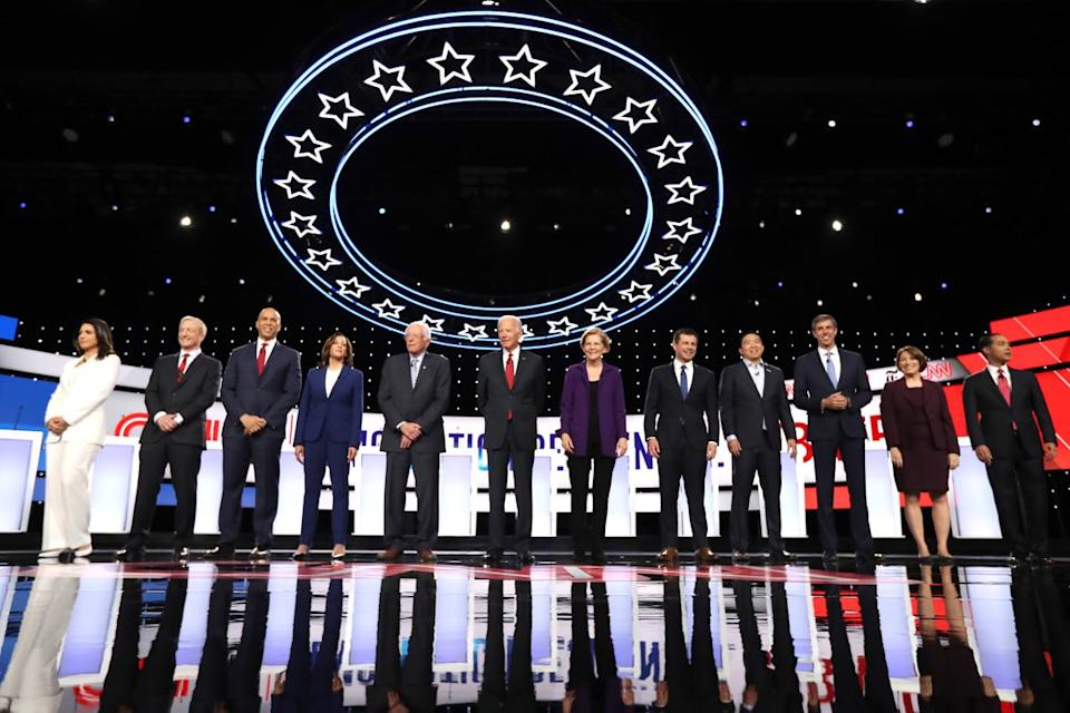 "<div class=""inline-image__caption""><p>Democratic presidential candidates (L-R) Rep. Tulsi Gabbard (D-HI), billionaire Tom Steyer, Sen. Cory Booker (D-NJ), Sen. Kamala Harris (D-CA), Sen. Bernie Sanders (I-VT), former Vice President Joe Biden, Sen. Elizabeth Warren (D-MA), South Bend, Indiana Mayor Pete Buttigieg, former tech executive Andrew Yang, former Texas congressman Beto O'Rourke, Sen. Amy Klobuchar (D-MN), and former housing secretary Julian Castro at the start of the Democratic Presidential Debate at Otterbein University on October 15, 2019 in Westerville, Ohio. A record 12 presidential hopefuls are participating in the debate hosted by CNN and The New York Times. </p></div> <div class=""inline-image__credit"">Chip Somodevilla/Getty</div>"
