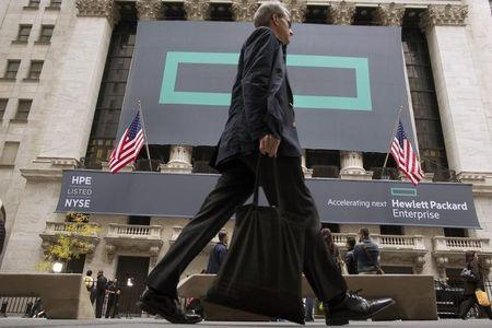 Signs for Hewlett Packard Enterprise Co. cover the facade of the New York Stock Exchange
