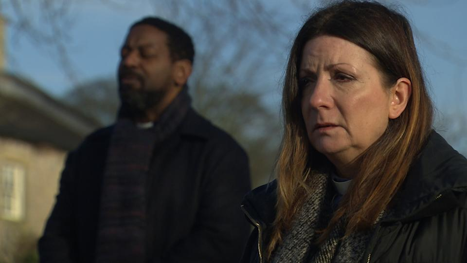 FROM ITV  STRICT EMBARGO  Print media - No Use Before Tuesday 2nd March 2021 Online Media - No Use Before 0700hrs  Tuesday 2nd March 2021  Emmerdale - Ep 8993  Friday 12th March 2021  As Charles Charles [KEVIN MATHURIN] leads them in a prayer for Richard, the man being exhumed, Harriet Finch [KATHERINE DOW-BLYTON] is restless, wanting to be left alone.  When one of the foremen is startled by something unusual at the digging site, she freezes with fear...   Picture contact David.crook@itv.com   This photograph is (C) ITV Plc and can only be reproduced for editorial purposes directly in connection with the programme or event mentioned above, or ITV plc. Once made available by ITV plc Picture Desk, this photograph can be reproduced once only up until the transmission [TX] date and no reproduction fee will be charged. Any subsequent usage may incur a fee. This photograph must not be manipulated [excluding basic cropping] in a manner which alters the visual appearance of the person photographed deemed detrimental or inappropriate by ITV plc Picture Desk. This photograph must not be syndicated to any other company, publication or website, or permanently archived, without the express written permission of ITV Picture Desk. Full Terms and conditions are available on  www.itv.com/presscentre/itvpictures/terms