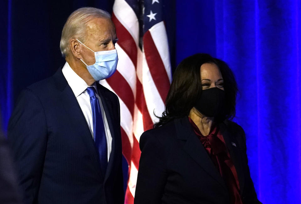 WILMINGTON, DELAWARE - NOVEMBER 06: Democratic presidential nominee Joe Biden and vice presidential nominee Sen. Kamala Harris (D-CA)  take the stage to address the nation at the Chase Center November 06, 2020 in Wilmington, Delaware.  The winner of the 2020 presidential election has yet to be declared, as vote counting continues in the key states of Pennsylvania, Georgia, Nevada, Arizona, and North Carolina. (Photo by Drew Angerer/Getty Images)
