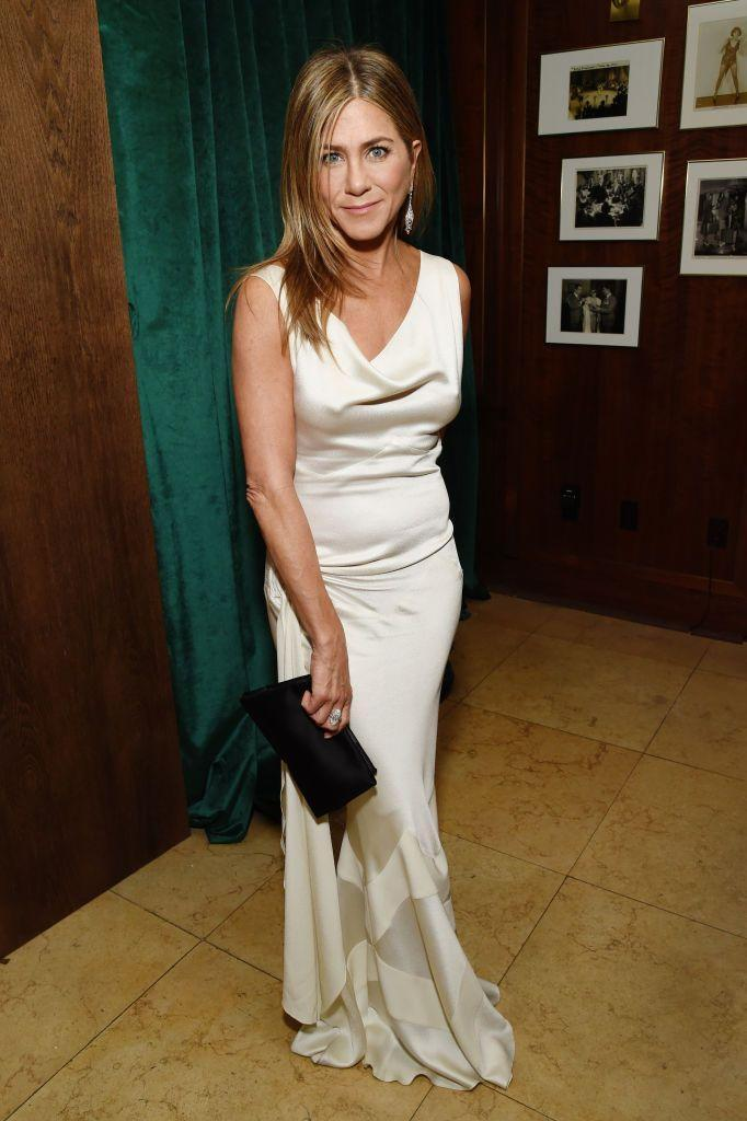 """<p>Jennifer Aniston wore a vintage Christian Dior by John Galliano silk bias-cut dress to pick up her Best Actress in a Drama Series award for her work in The Morning Show.</p><p>The gorgeous dress, that she was wearing during her <a href=""""https://www.elle.com/uk/life-and-culture/a30591052/jennifer-aniston-brad-pitt-sag-awards/"""" rel=""""nofollow noopener"""" target=""""_blank"""" data-ylk=""""slk:public reunion with ex-husband Brad Pitt"""" class=""""link rapid-noclick-resp"""">public reunion with ex-husband Brad Pitt</a>, is part of the Friends actor's personal collection.</p><p>'This is John Galliano for Christian Dior, this is a vintage dress that I sort of gave to myself as a present,' Aniston told Entertainment Tonight. 'This is an investment. These are designers that are working for particular houses – I only have a couple.'</p>"""