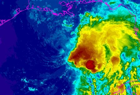 Tropical Storm Karen is seen in a National Oceanic and Atmospheric Administration (NOAA) Geostationary Operational Environmental Satellite (GOES) East infrared enhanced satellite image taken at 21:45 EST (00:45 GMT) October 4, 2013, and provided by NOAA. Authorities issued mandatory evacuation orders for low-lying areas south of New Orleans on Friday as the weakened Tropical Storm Karen closed in on the Louisiana coast after disrupting U.S. energy output in the Gulf of Mexico. REUTERS/NOAA/Handout via Reuters (UNITED STATES - Tags: ENVIRONMENT) ATTENTION EDITORS – THIS IMAGE WAS PROVIDED BY A THIRD PARTY. FOR EDITORIAL USE ONLY. NOT FOR SALE FOR MARKETING OR ADVERTISING CAMPAIGNS. THIS PICTURE WAS PROCESSED BY REUTERS TO ENHANCE QUALITY. AN UNPROCESSED VERSION WILL BE PROVIDED SEPARATELY