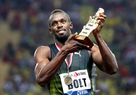Athletics - IAAF Diamond League Herculis meeting - 100m Men - Louis II Stadium, Monaco - July 21, 2017. Jamaican sprinter Usain Bolt reacts after receiving a Lifetime Achievement trophy.     REUTERS/Eric Gaillard