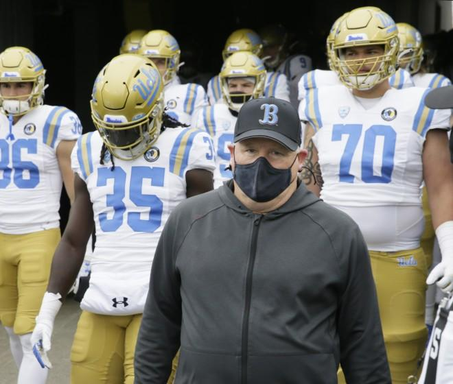 UCLA coach Chip Kelly leads his team on the field before its game against Oregon on Nov. 21, 2020, in Eugene, Ore.