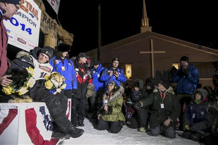 Dallas Seavey sits with his lead dogs at the finish after winning the Iditarod dog sled race in Nome, Alaska, March 11, 2014. REUTERS/Nathaniel Wilder