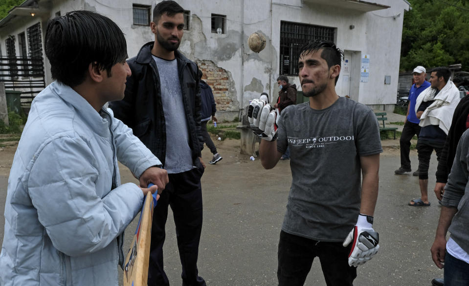Migrants prepare to play cricket in Blazuj migrant camp in Bosnia's capital of Sarajevo Wednesday, May 19, 2021. The Rome-based Baobab Experience group brought cricket equipment for the migrants in the Blazuj camp and also the central town of Tuzla, offering a rare opportunity for relaxation and fun for the people who spend months, if not years, stuck in camps while fleeing war and poverty in their nations and chasing their dreams of a better future. (AP Photo/Kemal Softic)