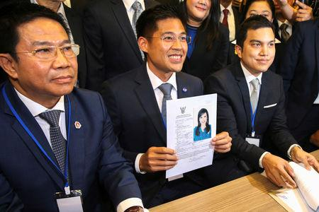 Thai Raksa Chart party leader Preechapol Pongpanich, holds up the application of candidate for Prime Minister, Thailand's Princess Ubolratana Rajakanya Sirivadhana Barnavadi, at the election commission office in Bangkok, Thailand February 8, 2019. REUTERS/Athit Perawongmetha