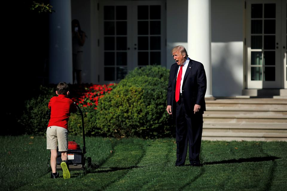 U.S. President Donald Trump welcomes 11-year-old Frank Giaccio as he cuts the Rose Garden grass at the White House in Washington, U.S., September 15, 2017. Frank, who wrote a letter to Trump offering to mow the White House lawn, was invited to work for a day at the White House along the National Park Service staff. REUTERS/Carlos Barria     TPX IMAGES OF THE DAY