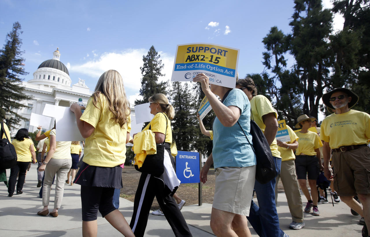 <p> FILE - In this Sept. 24, 2015 file photo supporters of a measure to allow terminally ill people to end their own life march at the Capitol in Sacramento, Calif. California health officials say 374 terminally ill people took drugs to end their lives in 2017, the first full year after a law making the option legal took effect. They added, 577 people received aid-in-dying drugs in 2017, but not everyone used them. (AP Photo/Rich Pedroncelli, File) </p>