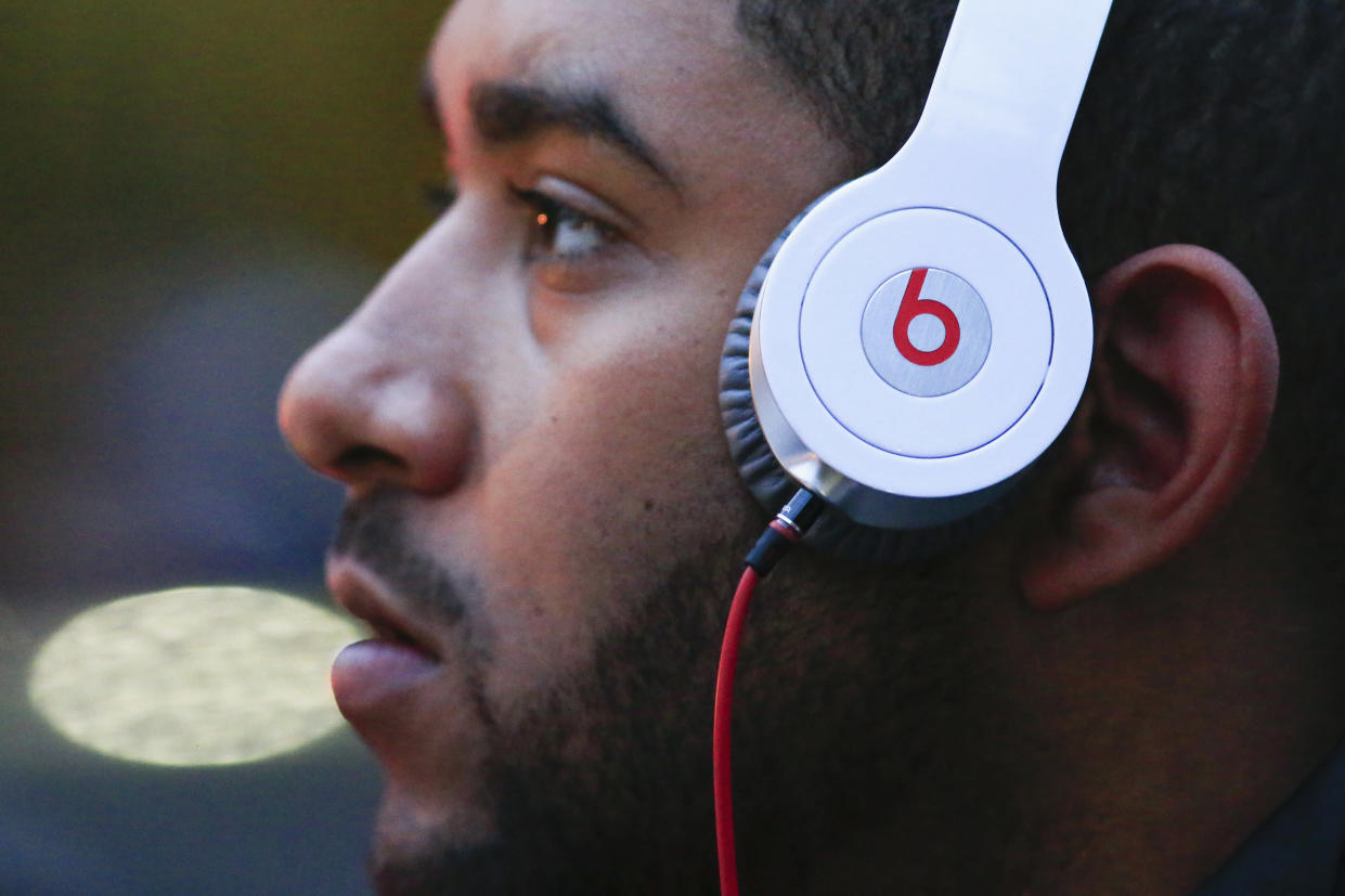 A man listens to Beats brand headphones on a street in New York, May 29, 2014. Apple bought beats for $3 billion. REUTERS/Eduardo Munoz (UNITED STATES - Tags: BUSINESS)