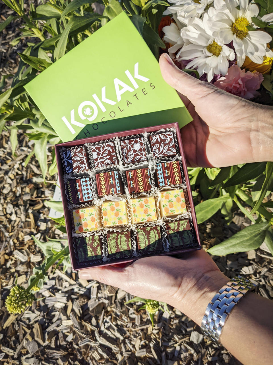 """<p>Mom's tastebuds will go on a tropical vacation when she indulges in these velvety smooth mango, passion fruit, and pineapple-flavored <a href=""""https://www.kokakchocolates.com/product/ttf/123?cs=true&cst=custom"""" rel=""""nofollow noopener"""" target=""""_blank"""" data-ylk=""""slk:truffles"""" class=""""link rapid-noclick-resp"""">truffles</a> from Kokak Chocolates.</p> <p><strong>$23.50-$40.95, <a href=""""https://www.kokakchocolates.com/product/ttf/123?cs=true&cst=custom"""" rel=""""nofollow noopener"""" target=""""_blank"""" data-ylk=""""slk:kokakchocolates.com"""" class=""""link rapid-noclick-resp"""">kokakchocolates.com</a></strong></p> <p><strong>*Use discount code MOM21 for 5% off </strong></p>"""