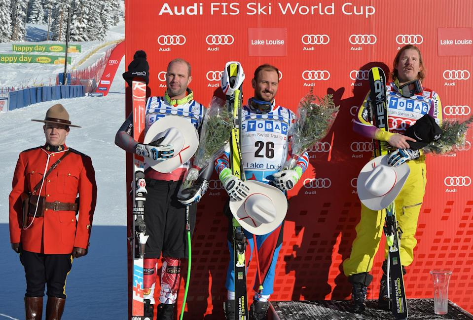 Kjetil Jansrud of Norway (R) celebrates on the podium after winning the Men's Downhill race beside joint-second place winners Manuel Osborne-Paradis of Canada (2n L) and Guillermo Fayed of France (C) at Lake Louise, Canada on November 29, 2014 (AFP Photo/Mark Ralston)